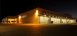 A business building at night light up with ample exterior security lights