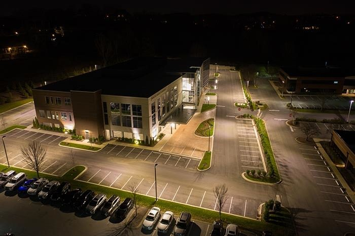 Aerial photo of a very well lit business parking lot at night