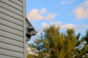Security light on a home pointing at the yard