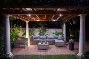 Covered outdoor patio lit from above at night